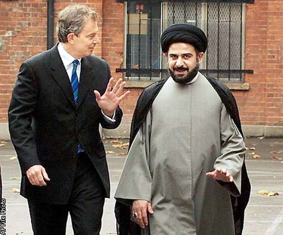 FILE PHOTO SHOWS KILLED SHI'ITE LEADER ABDUL MAJID AL-KHOEI MEETING BRITAIN'S PRIME MINISTER BLAIR AT THE AL KHOEI FOUNDATION IN LONDON Photo: POOL