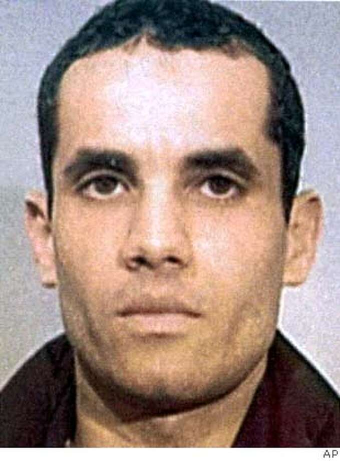 ** FILE ** Algerian Ahmed Ressam is seen in this undated police handout photo. The 9th U.S. Circuit Court of Appeals in San Francisco Tuesday, Jan. 16, 2007, reversed his conviction on one of nine charges of which he was convicted and sent the case back to a lower court to issue a new sentence and explain the rationale behind the original 22-year term. Ressam was arrested near the U.S.-Canadian border and convicted of plotting to bomb Los Angeles International Airport at the turn of the millennium. (AP Photo/CP, Police Handout via Le Journal de Montreal)
