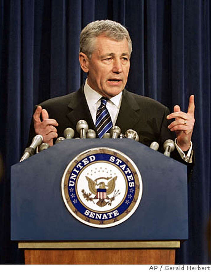 "Sen. Chuck Hagel, R-Neb., speaks at a press conference on Capitol Hill in Washington in this Monday, March 7, 2005 file photo. Majority Republicans are chipping away at Senate Democrats' ability to defeat a change in internal rules involving filibusters _ the Democrats' most potent weapon to block GOP legislation and judicial appointees they oppose. Hagel, who is on the fence regarding the filibusters, said ""I've said to both sides, don't include me in your count right now."" (AP Photo/Gerald Herbert, File) Ran on: 04-18-2005  Sen. Chuck Hagel Photo: GERALD HERBERT"