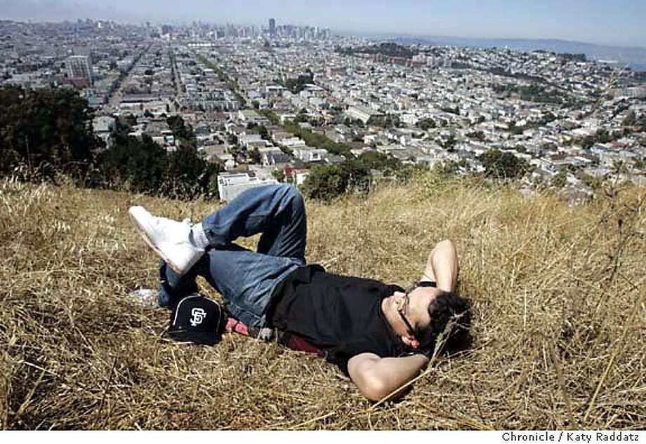 ONTHETOWN1006_RAD.JPG SHOWN: Mark Farina enjoys the afternoon sunshine on Bernal Hill Park. Mark Farina is a disc jockey (a DJ) of national reputation. He has several favorite places in San FRancisco (where he lives). One of his favorite places is Bernal Hill Park. Photo taken on 6/30/05, in San Francisco, CA.  By Katy Raddatz / The San Francisco Chronicle MANDATORY CREDIT FOR PHOTOG AND SF CHRONICLE/ -MAGS OUT Photo: Katy Raddatz