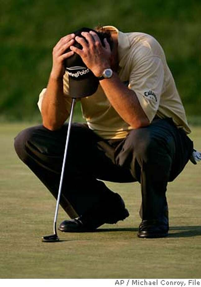 ** FILE ** Phil Mickelson waits to putt on the 18th hole in the final round of the U.S. Open golf tournament at Winged Foot Golf Club in Mamaroneck, N.Y., in this June 18, 2006 file photo. (AP Photo/Michael Conroy, File) Photo: Michael Conroy