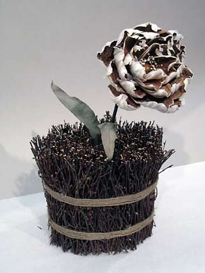 Slug: Section: home Pub date 1-17-07 Credit: Urban Forest Home Caption: preserved natural peony in twigs Photo: Credit: Urban Forest Home