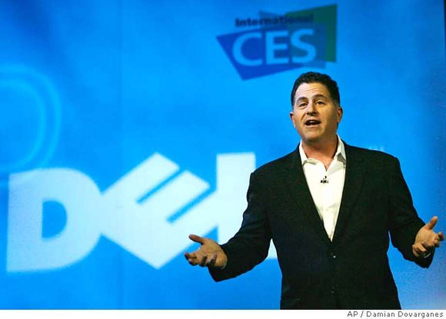Michael Dell Founder and Chairman, Dell Inc. urges the electronics industry to foster the planting of trees in order to offset the impact of their devices energy consumption on the environment at his keynote speech at the 2007 International Consumer Electronics Show (CES) in Las Vegas, Tuesday, Jan. 9, 2007. (AP Photo/Damian Dovarganes) Photo: Damian Dovarganes