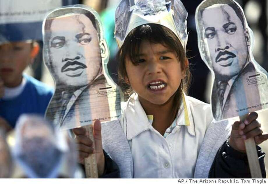 Samantha Sanchez, 5, and other students from Martin Luther King Jr. Elementary School march in the MLK Parade, Thursday, Jan. 11, 2007, in Phoenix. Monday is the official holiday honoring King. (AP Photo/The Arizona Republic, Tom Tingle) ** MARICOPA COUNTY OUT, MESA TRIBUNE OUT, MAGS OUT, ** Photo: Tom Tingle