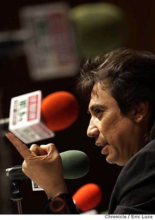 "Radio show host Renan Almendarez Coello, ""El Cucuy de la Manana,"" faces reporters to announce the end of his morning show on the Hispanic Broadcasting Corporation's KSCA La Nueva (101.9) in Beverly Hills, Calif., Tuesday, Jan. 28, 2003. After 16 years of morning broadcasts, Coello will host an afternoon show, pursue a television career and devote more time to his charity, ""The El Cucuy de la Manana Foundation."" (AP Photo/Lucy Nicholson) Photo: LUCY NICHOLSON"