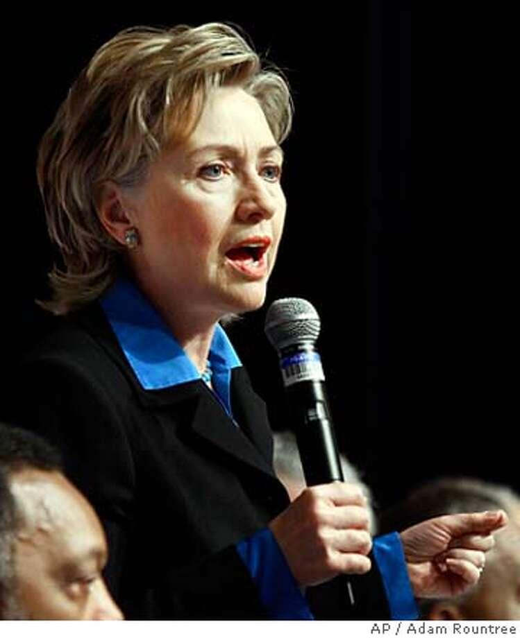 Sen. Hillary Rodham Clinton, D-N.Y., center, speaks as Rev. Jesse Jackson, left, looks on during the 10th Annual Rainbow Push Wall Street Project Conference held at the Sheraton Hotel in New York City on Monday, Jan. 8, 2007. (AP Photo/Adam Rountree) Photo: ADAM ROUNTREE