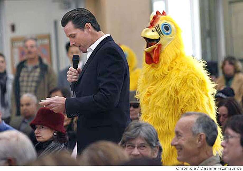 newsom14_0083_df.jpg  Project Chicken Connect had about a half dozen people dressed as chickens attend Mayor Gavin Newsom's town hall meeting at the Richmond Recreation Center. Mayor Newsom won't take questions from the board of supervisors as voters in November asked him to do, so instead he is having this town hall meeting. The chickens claim he is chicken.  Photographed in San Francisco on 1/13/07. Photo / Deanne Fitzmaurice Mandatory credit for photographer and San Francisco Chronicle. /Magazines out. Photo: Deanne Fitzmaurice