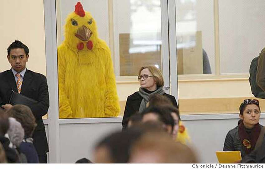 newsom14_0095_df.jpg Project Chicken Connect had about a half dozen people dressed as chickens attend Mayor Gavin Newsom's town hall meeting at the Richmond Recreation Center. Mayor Newsom won't take questions from the board of supervisors as voters in November asked him to do, so instead he is having this town hall meeting. The chickens claim he is chicken. Photographed in San Francisco on 1/13/07. Photo / Deanne Fitzmaurice Mandatory credit for photographer and San Francisco Chronicle. /Magazines out.