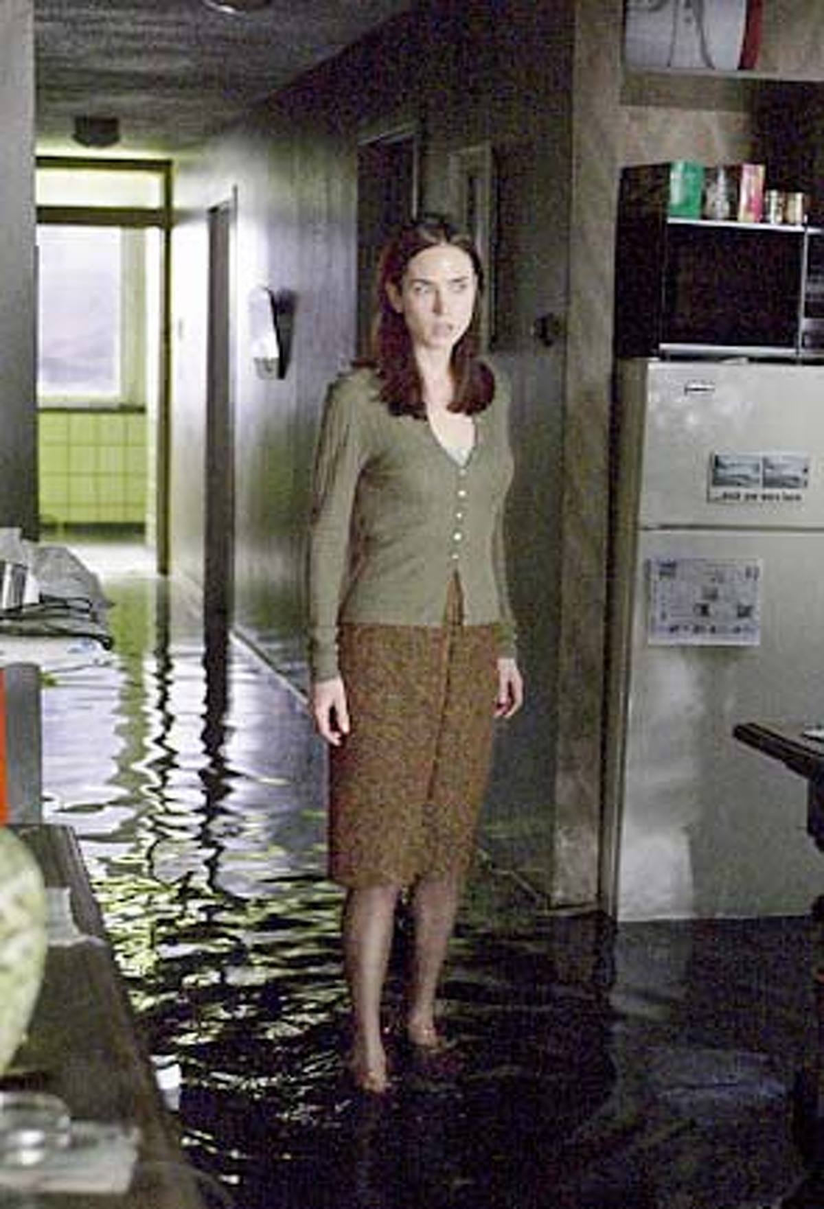 In this photo provided by Touchstone Pictures, Dahlia Williams (Jennifer Connelly) discovers her new apartment - dilapidated, cramped, and worn - seems to take on a life of its own in