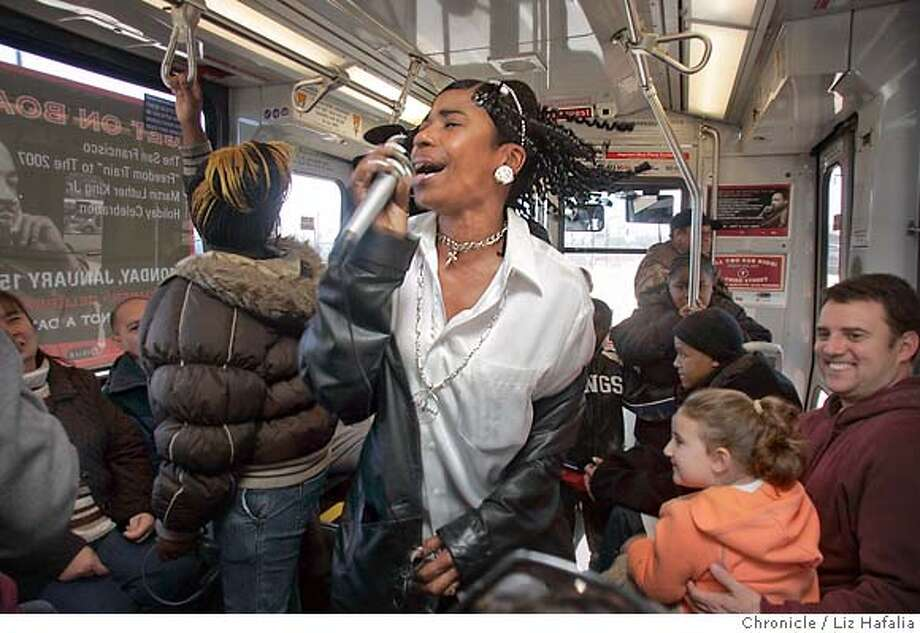 "Yolanda Irene James sings ""We Are Family"" while riding the 3rd St. Rail, dubbed the first San Francisco freedom train, en route to Martin Luther King Jr. festivities at the Civic Center in San Francisco, Monday, Jan. 15, 2007. (AP Photo/San Francisco Chronicle, Liz Hafalia) ** MANDATORY CREDIT, MAGS OUT, ** MANDATORY CREDIT, MAGS OUT, Photo: Liz Hafalia"
