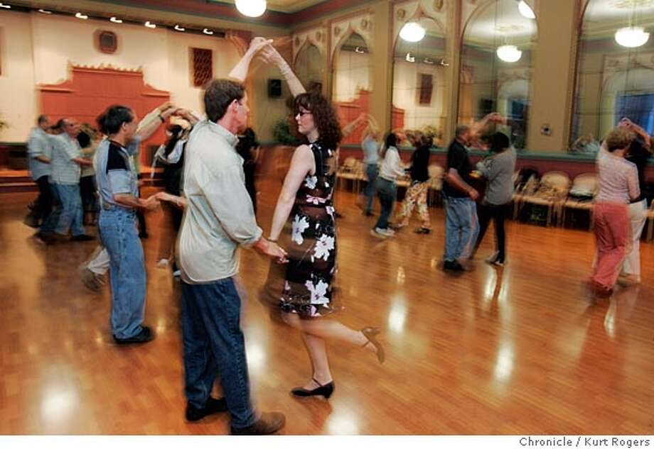 Connecting Through Dance (CTD), a Bay Area nonprofit at the Lake Merritt Dance Center in Oakland, teaches weekly partner dancing classes to visually impaired persons (VIPs) and sighted participants. VIPs learn basic foot positions and the components of dancing while sighted volunteers train as their �guide dancers� in Ballroom, Latin, Swing and other partner dances. Many VIPs in the program are newly blind. The classes provide a physical benefit (gaining a better sense of balance and coordination) and, in the words of one participant, �a way to have fun and forget about being blind.�  Gene Russo, a former competitive ballroom dancer, started the program five years ago. He's taught dance for over 40 years. His own struggles with dyslexia gave him empathy for those with disabilities and generated a lifelong fascination with different forms of communication 6/8/05 in Oakland,CA.  KURT ROGERS/THE CHRONICLE Photo: KURT ROGERS
