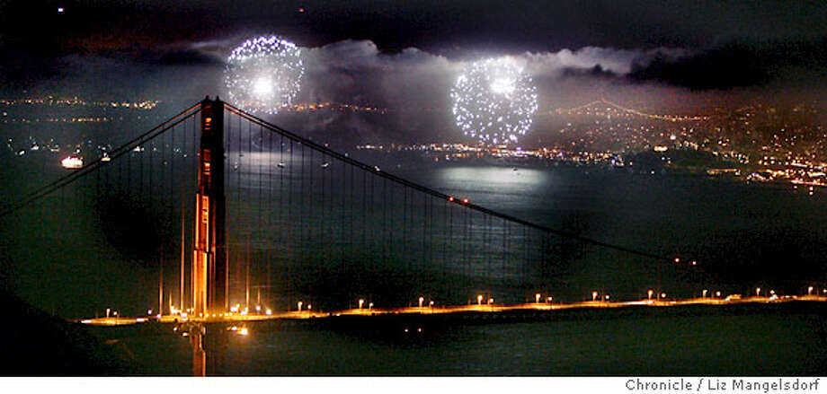 Fireworks add dramatic bursts of light and thunder to the San Francisco skyline, viewed from the Marin Headlands looking toward the Golden Gate Bridge. Chronicle photo by Liz Mangelsdorf