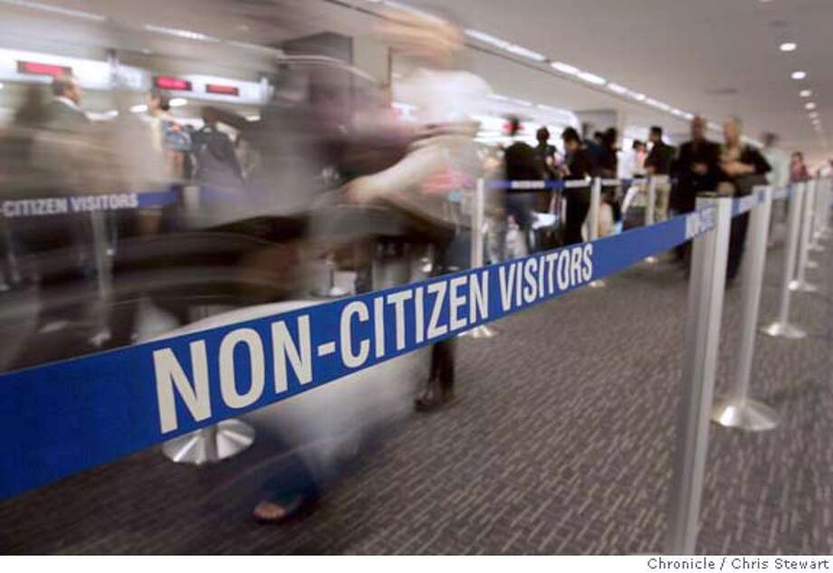 visas21263.jpg  Event on 6/17/05 in Millbrae. Foreign travelers queue up at primary passport control before handing immigration and customs forms to customs and border protection officers upon arrival at San Francisco International Airport. Non U.S. citizens traveling to the U.S. from overseas face increasing difficulties in the security-conscious, post-Sept. 11 era.  Chris Stewart / The Chronicle MANDATORY CREDIT FOR PHOTOG AND SF CHRONICLE/ -MAGS OUT Photo: Chris Stewart