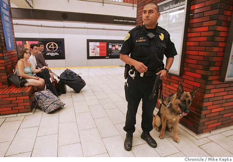 BART077_mk.JPG Knowing there is a heightened security alert after Thursday morning bombings in London, BART K-9 Patrol Officer, Michael Zendejas and his 3-year-old dog Tim patroll BART stations on the East Bay side of the transbay tube Thursday. 7/6/05 Mike Kepka / The Chronicle MANDATORY CREDIT FOR PHOTOG AND SF CHRONICLE/ -MAGS OUT Photo: Mike Kepka