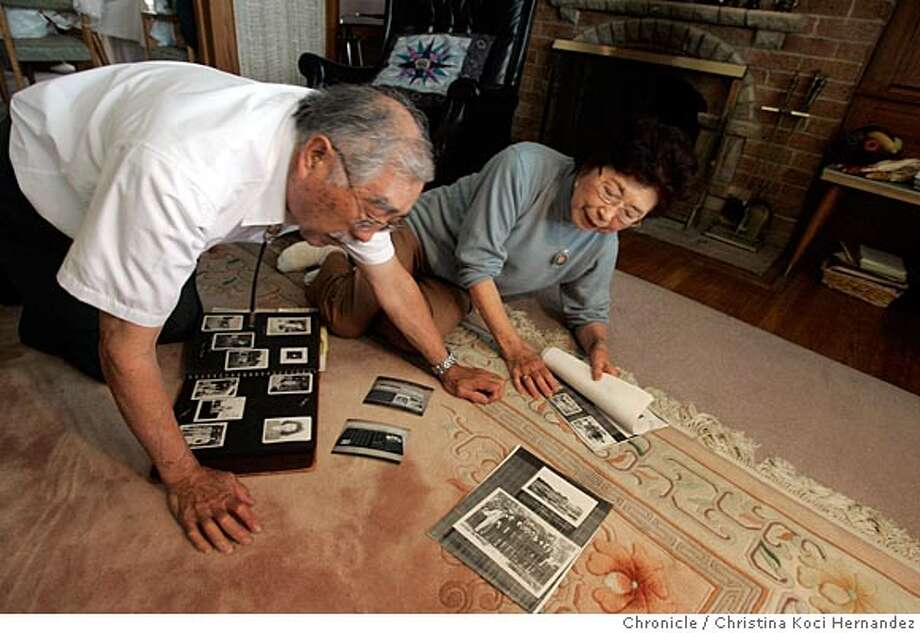 "CHRISTINA KOCI HERNANDEZ/CHRONICLE Mas and Ida look at old ohotos and scrapbooks from their internment camps.Masura ""Mas"" Kawaguchi, a San Francisco resident interned at 16, was in the middle of his junior year at George Washington High School when his family was shipped by train to an internment camp the desert in Utah.  Kawaguchi got his high school diploma in 1997 from George Washington High School, 54 years after he gradated. He has been encouraging other Japanese Americans to take advantage of a one-year-old law that requires school districts to issue diplomas. He doesn't want anyone to forget what happened to Japanese Americans during World War II.  Kawaguchi's wife, Ida, was also interned. But her high school, located in a small south of Fresno, gave her a diploma when she graduated from the high school in the interment camp. Photo: CHRISTINA KOCI HERNANDEZ"