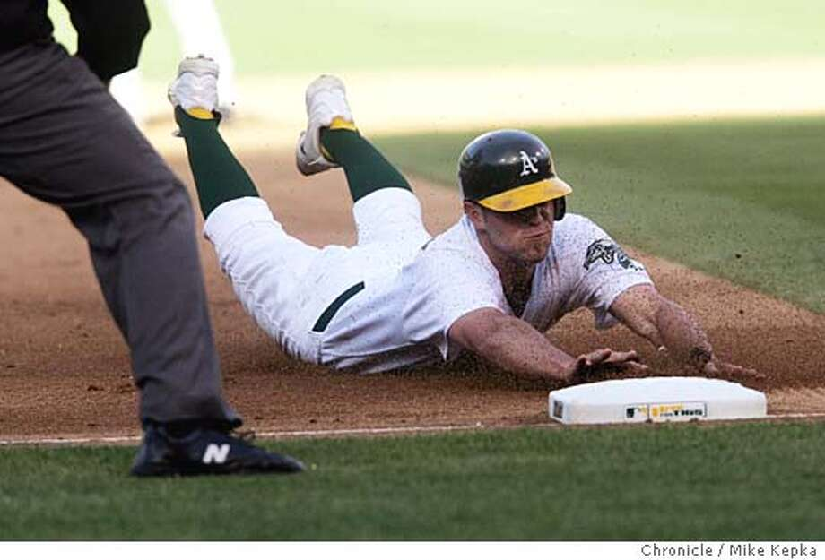 A's #7 Bobby Crosby stole 3rd in the 4th after hitting a run double. Next hit he came home.  Oakland A's vs. the Chicago White Sox at Oakland 7/1/05 Mike Kepka / The Chronicle Photo: Mike Kepka