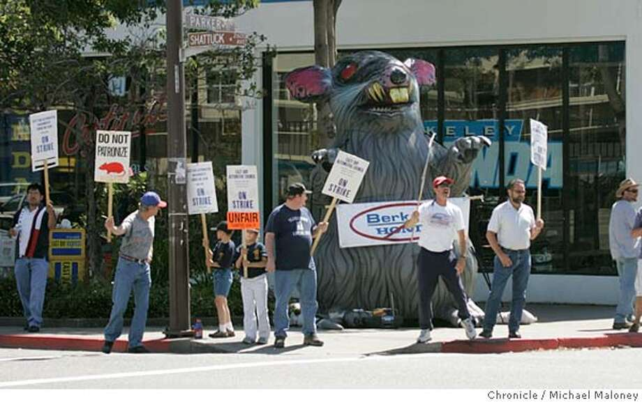 "HONDA_114_MJM.jpg  Former employees of Berkeley's Doten Honda are picketing outside the longtime high-volumn dealership after it's new owner laid off union service workers and set up a non-union shop on Shattuck Avenue in liberal Berkeley. Workers also set up a giant inflated rat on the street corner and are asking customers not to take their business there. The new owner is Stephen Bienke, son of a Danville developer who painted ""Strike Sale"" in the showroom window.  Photo by Michael Maloney / San Francisco Chronicle MANDATORY CREDIT FOR PHOTOG AND SF CHRONICLE/ -MAGS OUT Photo: Michael Maloney"
