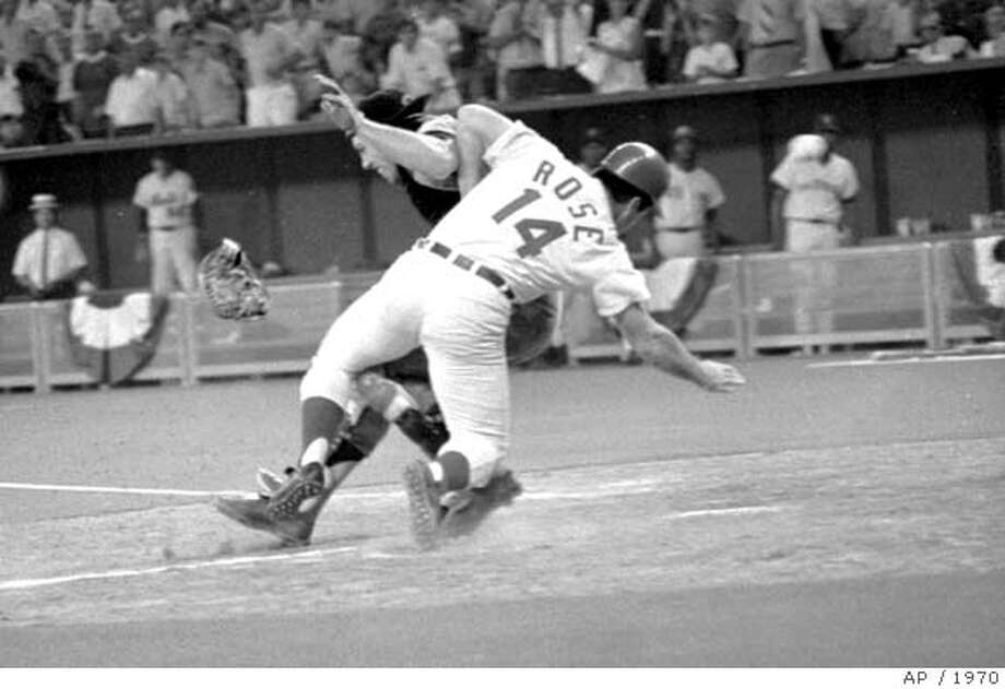 National League's Pete Rose cracks into American League catcher Ray Fosse as he scores winning run in bottom of the 12th inning during July 14, 1970 All-Star game in Cincinnati. Ray Fosse was taken to a local hospital for observation. Rose scored from second on Jim Hickman's single to center. (AP photo/stf) ALSO RAN 12/30/02 CAT