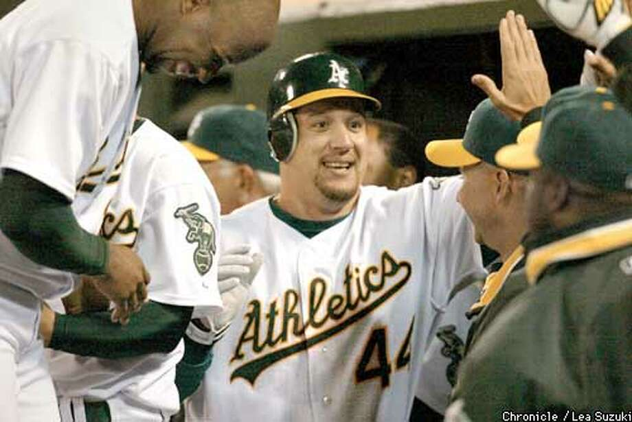 Erubiel Durazo celebrates with teammates after bringing in the run that pulled the A's ahead by 1 run in bottom of the 7th. A's win the game against the Anaheim Angels on Sunday, April 6, 2003 by a final score of 7 to 6. Photo By LEA SUZUKI/SAN FRANCISCO CHRONICLE  NORTHERN CA MANDATORY CREDIT  PHOTOG AND SF CHRONICLE/ -MAGS OUT Photo: LEA SUZUKI