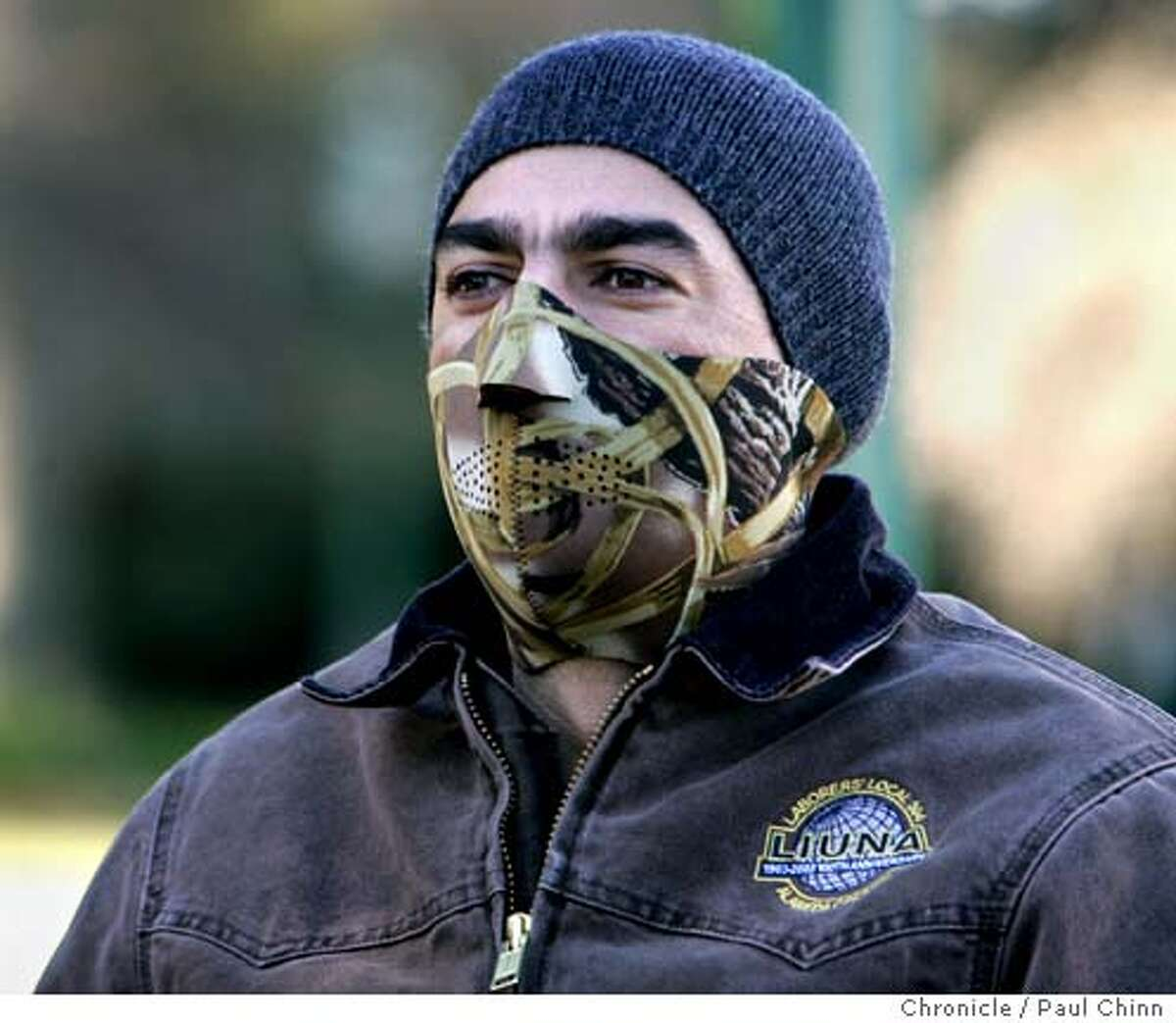 Fernando Estrada used a thermal mask to keep warm on another morning of near freezing temperatures in Oakland, Calif. on Saturday, Jan. 13, 2007. PAUL CHINN/The Chronicle **Fernando Estrada