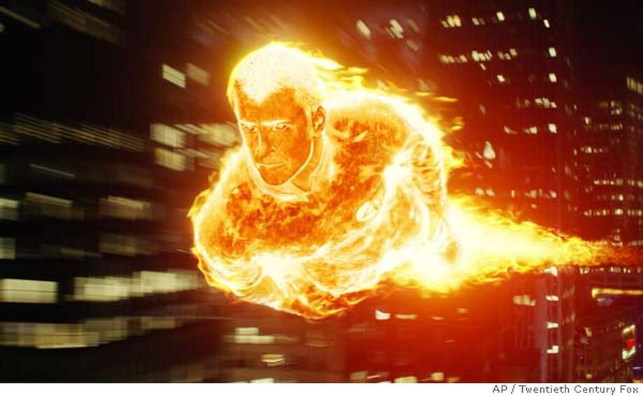 "In this photo provided by Twentieth Century Fox, The Human Torch (Chris Evans) flames on above the streets of New York City in ""The Fantastic Four."" (AP Photo/Twentieth Century Fox)."