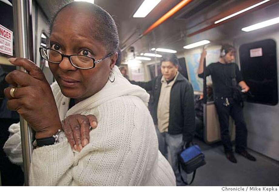 bart026_mk.jpg  Joann (cq) Jackson, of Antioch, is relieved to be heading to work at Williams Sonoma in San Francisco on her usual BART train. Her only plan of attack if BART wasn't operating was to somehow make it to West Oakland we she hoped she could catch a ride of a bus.  Morning commuters seem to riding BART trains as usual the morning after BART works threatened to strike if contract negotiations did not happen. At 3 a.m. Wednesday negotiations came together. 7/5/05 Mike Kepka / The Chronicle MANDATORY CREDIT FOR PHOTOG AND SF CHRONICLE/ -MAGS OUT Photo: Mike Kepka