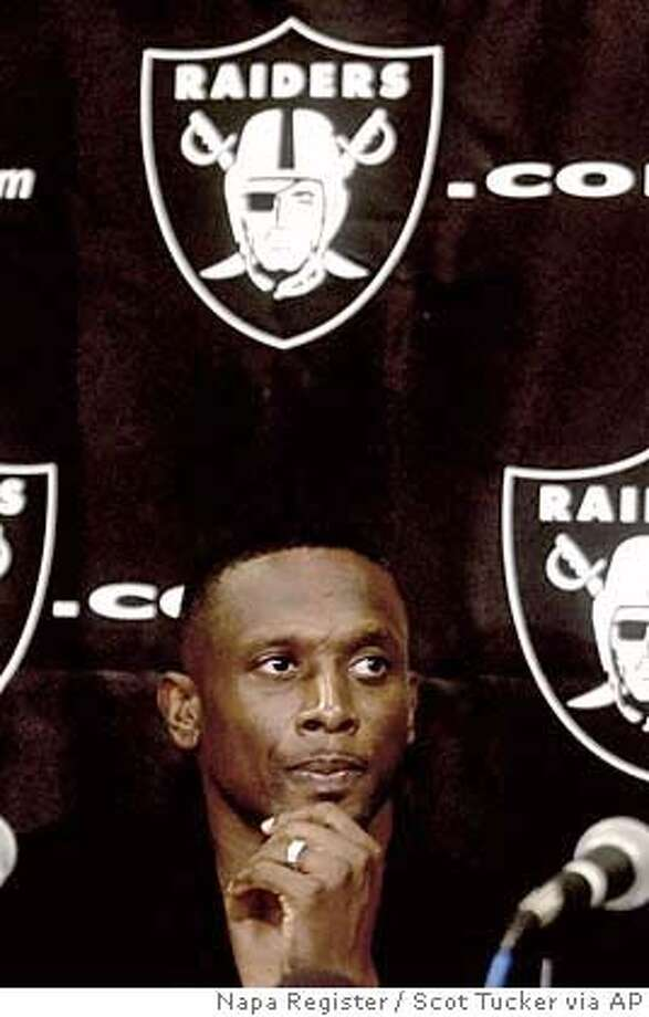 Tim Brown is shown at a news conference announcing his release from the Oakland Raiders in Napa, Calif., Wednesday, Aug. 4, 2004. Brown wants fans and teammates to remember him as the best receiver in Raiders history _ and not as an over-the-hill veteran who overstayed his welcome. Unwilling to accept a sharply reduced role in Oakland's offense, Brown will be released by the Raiders on Thursday after 16 seasons. The 38-year-old receiver agreed with owner Al Davis' decision to part ways with the last former member of the Los Angeles Raiders and the longest-tenured player in franchise history. (AP Photo/Napa Register, Scot Tucker) Ran on: 08-10-2004 Ran on: 08-10-2004 Ran on: 08-11-2004  Tim Brown is expected to fill Tampa Bay's short-term need for an experienced wide receiver. Ran on: 08-11-2004  Tim Brown is expected to fill Tampa Bay's short-term need for an experienced wide receiver. Ran on: 10-24-2004  Rich Gannon, who broke a vertebra on a hit by Tampa Bay's Derrick Brooks, is among the missing. Ran on: 10-24-2004  Rich Gannon, who broke a vertebra on a hit by Tampa Bay's Derrick Brooks, is among the missing. MAGS OUT MANDATORY CREDIT Photo: SCOT TUCKER