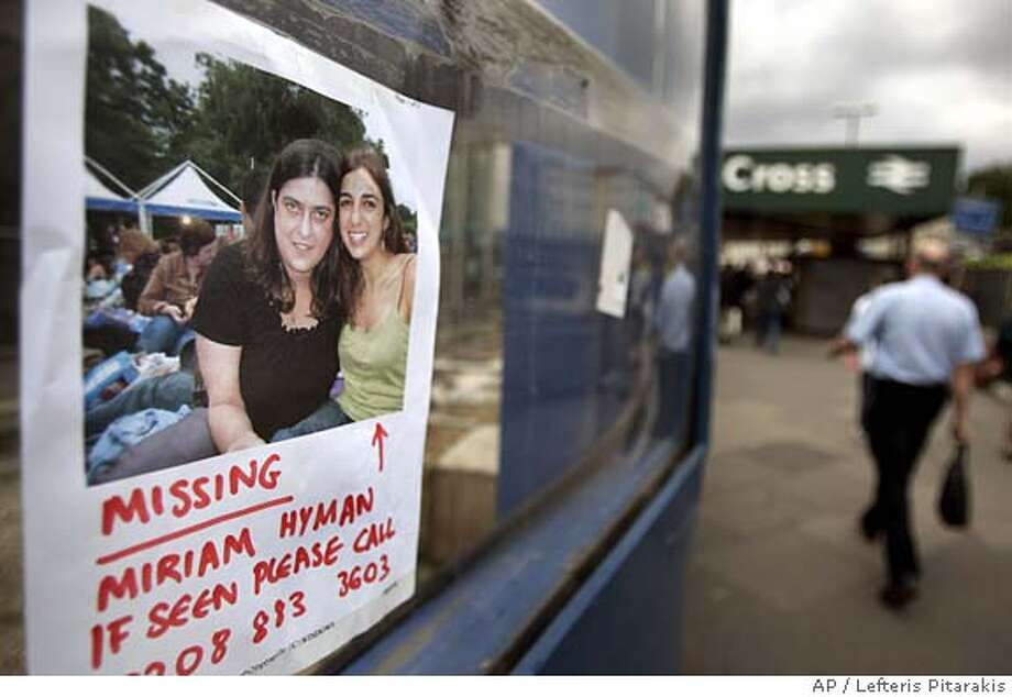 A poster left by relatives or friends of a missing person is seen where it has been hung near the entrance of the King's Cross Underground Station that was hit by an explosion Thursday, in central London, Friday July 8, 2005. Four explosions rocked the London subway and tore open a packed double-decker bus during the morning rush hour Thursday killing at least 50 people. (AP Photo/Lefteris Pitarakis) Photo: LEFTERIS PITARAKIS