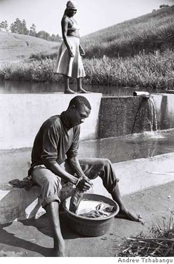 Man Washing Clothes, Natal 2003  Photo by Andrew Tshabangu  ONE TIME USE ONLY