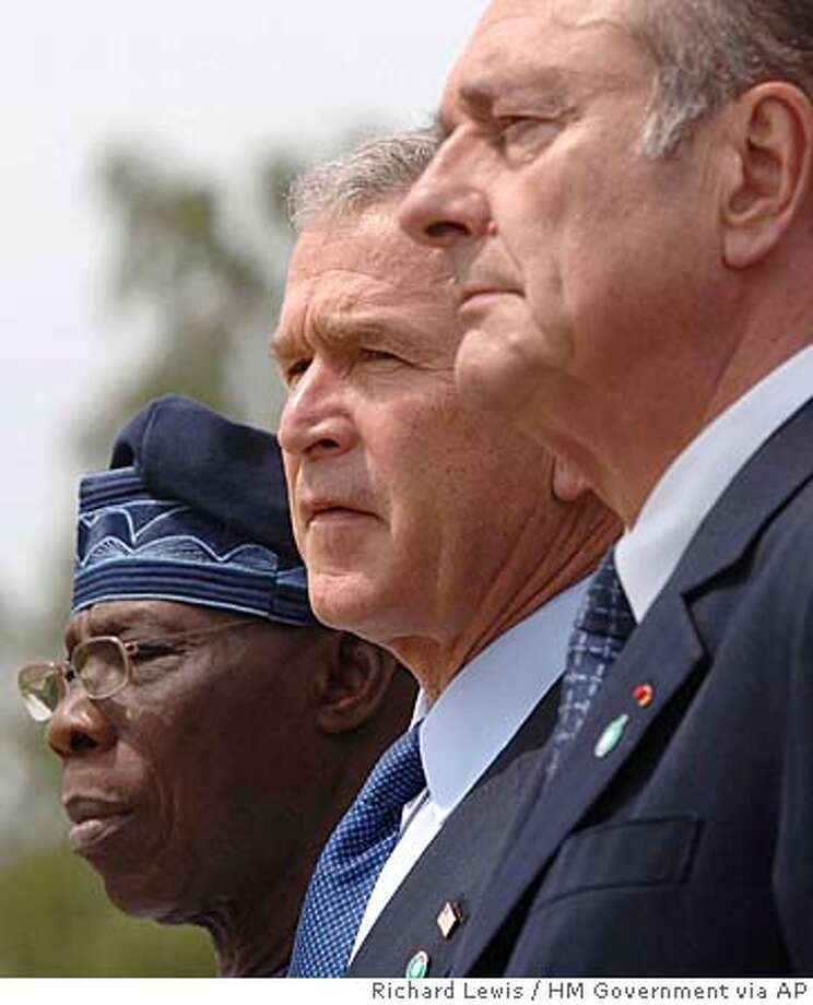 Nigerian President Olusengun Obasanjo, US President George W. Bush, and French President Jacques Chirac, stand together at the end of the G8 Summit at Gleneagles, Scotland, Friday July 8, 2005.(AP Photo/Richard Lewis/HM Government, ho) Photo: RICHARD LEWIS