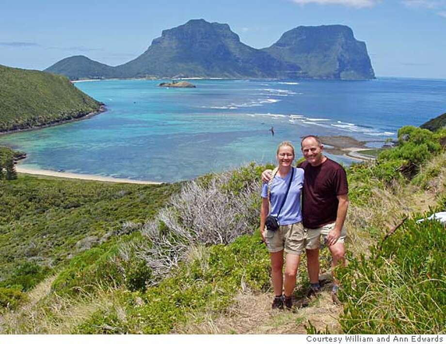 TRAVEL JUSTBACK -- William and Ann Edwards in front of a viw of the Lord Howe Island lagoon taken from Mt Elisa.  JAN. 14  William and Ann Edwards, Modesto Email: edw2800@earthlink.net  Daytime phone number: 209-521-0689  Just back from: Lord Howe Island, Australia  I went because: We wer on a quest to find the most beautiful remote snorkeling beach.  Don't miss: Ned's Beach is in a marine park and sits on a gorgeous reef. Every day hundreds of reef fish are hand fed.  Don't bother: renting a car. The main transportation for tourists is by foot or by bicycle.  Coolest souvenir: Pick up a book written by Ian Hutton a local naturalist, author and photographer. Attend one of his tours and take your book along to get it signed.  Worth a splurge: Don't miss out on a snorkel boat or glass bottom boat tour on hte lagoon. The reef is magnificent and should not be missed.  I wish I'd packed: less. Travel as light as possible. All you really need is a good pair of walking shoes.  Other comments: Lord Howe Island is on hte World Heritage list and they allow only 400 visitors on the island at any one time. This is an incredibly pristine place.  Details of attached photo (if sent): travel_justback_howeisland.jpg  12/31/-1 in , . Ran on: 01-14-2007  William and Ann Edwards in front of Lord Howe Island lagoon, Australia. Photo: Na