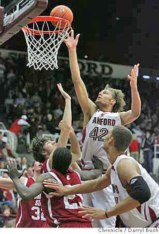 Stanford's Robin Lopez (42) shoots over Washington State's defenders in 1st half action; Stanford vs. Washington State at Stanford's Maples Pavilion in Stanford, CA, on Saturday, January, 13, 2007. photo taken: 1/13/07  Darryl Bush / The Chronicle ** roster (cq) Photo: Darryl Bush