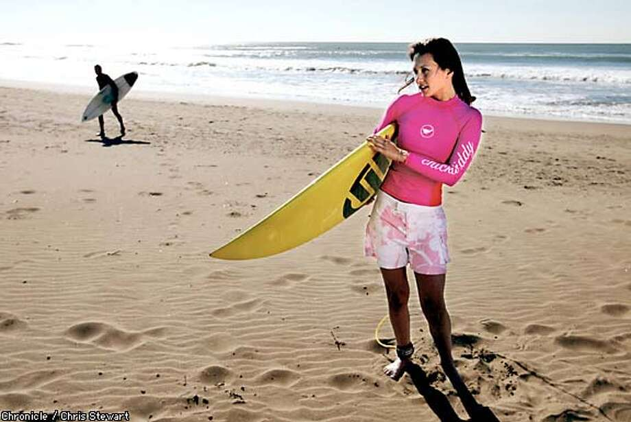 Above board: Surfer Maia Negre, co-owner of a Capitola surfing school, wears pink and white hibiscus-print boardshorts, about $44; and a hot pink long-sleeve rashguard, about $44, by Chickabiddy, a San Francisco company that makes athletic clothing for curvy women. Chronicle photo by Chris Stewart