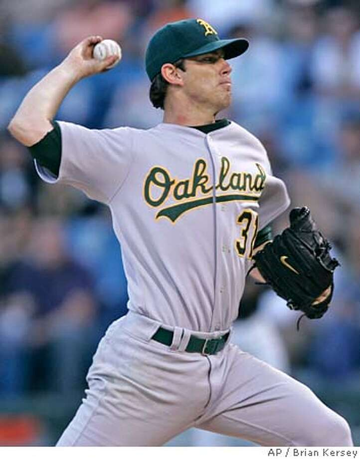 Oakland Athletics starting pitcher Kirk Saarloos delivers a pitch during the first inning against the Chicago White Sox, Friday, July 8, 2005, in Chicago. The Athletics won 4-2. (AP Photo/Brian Kersey) Photo: BRIAN KERSEY