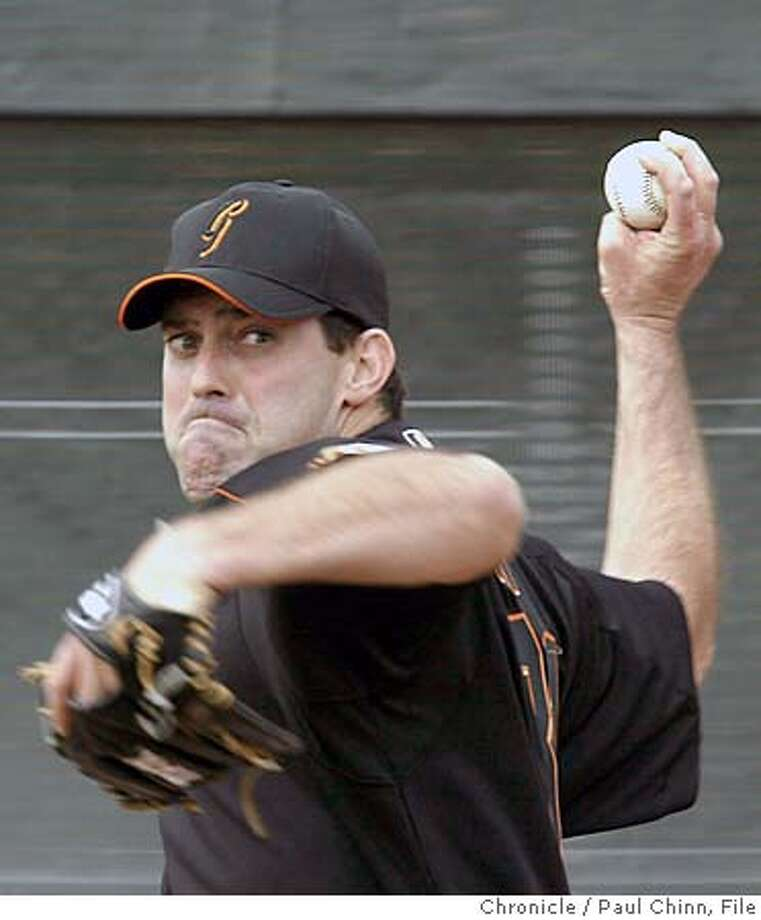 giants21_225_pc.JPG After missing the entire season last year, closer Robb Nen appeared to be healthy after throwing for several minutes at the workout. The San Francisco Giants held its first 2004 Spring Training workout on 2/20/04 in Scottsdale, AZ. also ran 04/29/04 PAUL CHINN / The Chronicle MANDATORY CREDIT FOR PHOTOG AND SF CHRONICLE/ -MAGS OUT Robb Nen throws off a mound for eight minutes, and manager Felipe Alou later said he looked &quo;nice and loose.&quo; Robb Nen threw off a mound for eight minutes, and manager Felipe Alou later said he looked &quo;nice and loose.&quo; ProductNameChronicle Ran on: 12-02-2004 Ran on: 12-02-2004 Sports#MainNews#Chronicle#02/21/2004#ALL#3star#a1#0421630713 Photo: PAUL CHINN