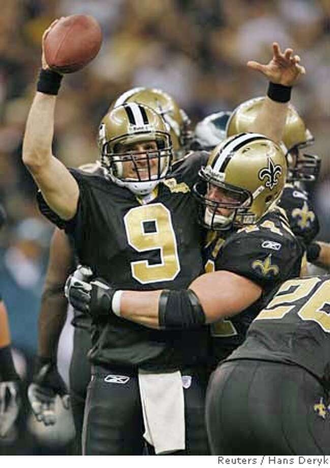 New Orleans Saints quarterback Drew Brees (L) celebrates with teammate Mike Karney at the end of their NFC Divisional NFL playoff football game against the Philadelphia Eagles in New Orleans, January 13, 2007. REUTERS/Hans Deryk (UNITED STATES)  Ran on: 01-14-2007  Saints quarterback Drew Brees definitely wasn't the only person with a big smile in New Orleans on Saturday night.  Ran on: 01-14-2007  Saints quarterback Drew Brees definitely wasn't the only person with a big smile in New Orleans on Saturday night. Photo: HANS DERYK