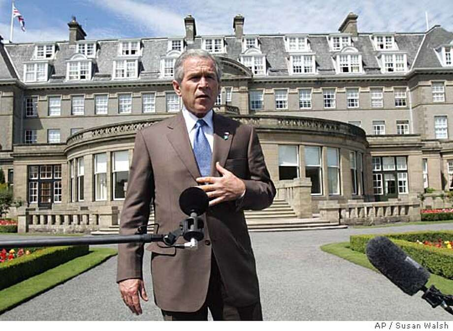 "U.S. President George W. Bush walks to make a statement at the Gleneagles Hotel near Auchterarder, Scotland, Thursday, July 7, 2005 on the expolsions in London. Describing events as ""incredibly vivid to me,"" Bush offered ""heartfelt condolences"" to the victims of the blasts and their families and said he backed British Prime Minister Tony Blair's determination in the face of the attacks. (AP Photo/Susan Walsh) Photo: SUSAN WALSH"