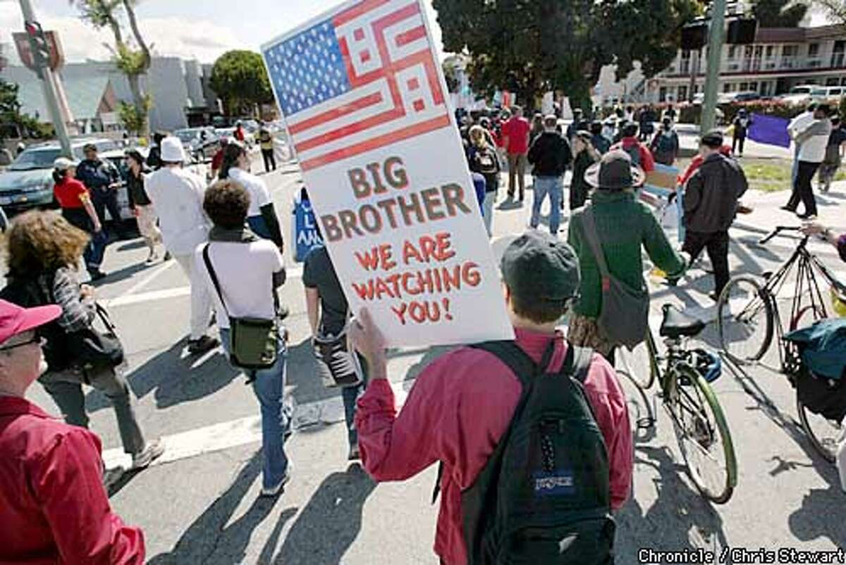 Bruce Hopkins of Albany carries a modified U.S. flag as he joined several thousand people staging a peaceful protest Saturday, April 5, 2003, as they marched through the streets of Berkeley and Oakland, California in opposition to the war in Iraq. CHRIS STEWART/SAN FRANCISCO CHRONICLE