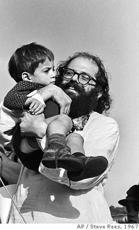 ** ADVANCE FOR SUNDAY, JAN 14, 2007 ** FILE ** Allen Ginsberg is shown holding an unidentified child in San Francisco, Sunday, Jan. 15, 1967. Ginsberg was one of many 1960's icons who appeared at the Human Be-in, a counterculture event that unofficially launched San Francisco's summer of love. In many ways, the '60s as we now know them began on Jan. 14, 1967. And while the decade may have a new meaning for a generation contemplating retirement, those who were in Golden Gate Park that day agreed that neither they nor San Francisco have been the same since. (AP Photo/Steve Rees) ** MAGS OUT ONLINE OUT NO TV **  Ran on: 01-14-2007  Allen Ginsberg holds a child at the Human Be-In in 1967.  Ran on: 01-14-2007  Allen Ginsberg holds a child at the Human Be-In in 1967. Photo: Steve Rees
