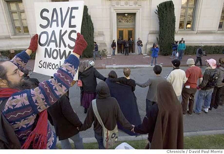BERKELEY, CA - JANUARY 12: Supporters of the oak tree sitters at Cal Berkeley stand in front of the chancellor's office as they protest the proposed cutting of the oak trees on campus on January 12, 2007 in Berkeley, California. The tree sitters have been camped out high in the trees, which the university plans to cut down to make room for a new athletic training facility, for over a month. (Photo by David Paul Morris/The Chronicle) Photo: David Paul Morris