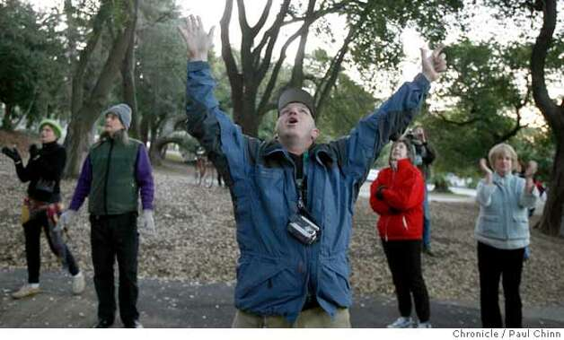 Dan McMullan and other supporters cheer the tree-sitters after the raid. UC police raided the base camp for tree-sitting protesters in front of Memorial Stadium in Berkeley, Calif. on Friday, Jan. 12, 2007. Police made no arrests when they made the pre-dawn raid but confiscated personal belongings of the campers. The tree sitters were not not disturbed and remain in the camped in the limbs.  PAUL CHINN/The Chronicle  **Dan McMullan Photo: PAUL CHINN
