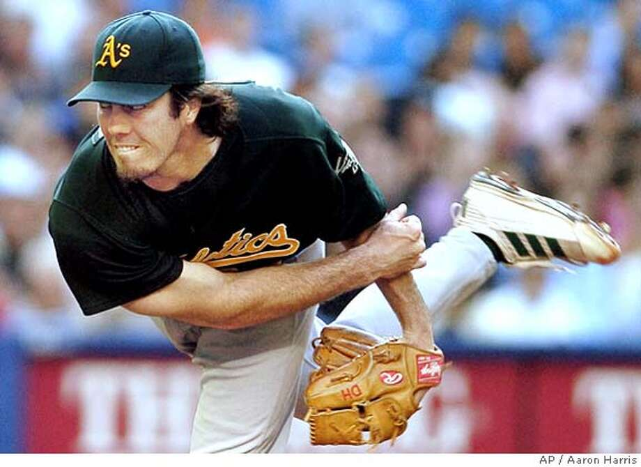 Oakland Athletics pitcher Danny Haren follows through on a pitch against the Toronto Blue Jays during first inning AL action in Toronto Tuesday July 5, 2005. (AP PHOTO/Aaron Harris, CP) Photo: AARON HARRIS
