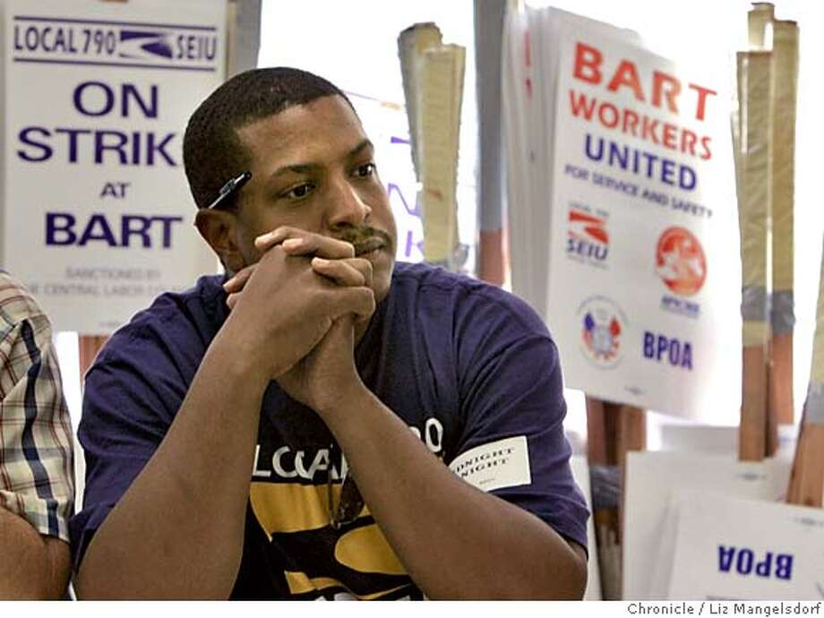 bart057_lm.JPG Event on 7/5/05 in Oakland.  Herb Holland, a track equipment operator for BART, listens during the start of the meeting, while the picket signs stand behind him.  Picket Captians from BART Unions SEIU Local 790 and ATU Local 1555 meet at SEIU Union headquarters in Oakland meet in preparation for a possible midnight strike by BART workers.  Liz Mangelsdorf / The Chronicle MANDATORY CREDIT FOR PHOTOG AND SF CHRONICLE/ -MAGS OUT Photo: Liz Mangelsdorf