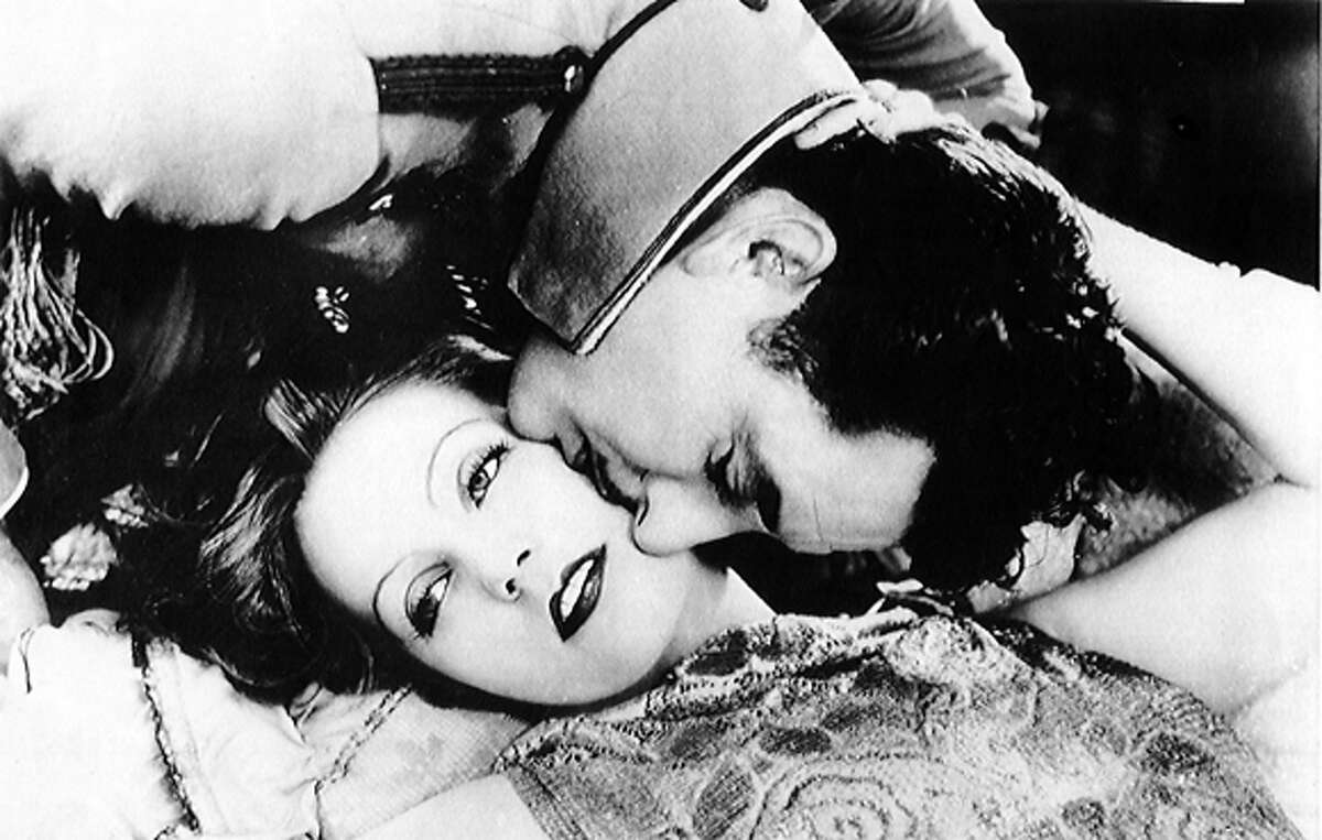 John Gilbert and Greta Garbo appear in the famed still shot in 1927 during filming of