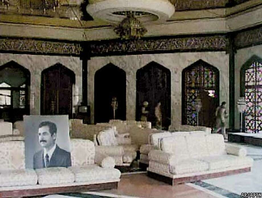 An ornate lounge is seen in a VIP building at the former Saddam International Airport Sunday, April 6, 2003, in Baghdad, Iraq, in this image from video. The terminal was used by top Iraqi officials allegedly including Iraqi President Saddam Hussein. (AP Photo/APTN)