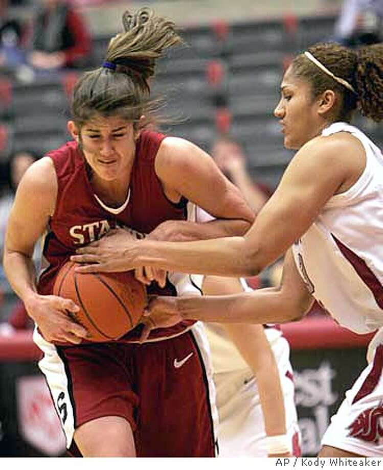 Washington State forward Marisa Stotler, right, wrestles for the ball against Stanford forward Brooke Smith in the first half on Saturday Jan. 13, 2007, in a college basketball game in Pullman, Wash. (AP Photo/Kody Whiteaker) Photo: Kody Whiteaker