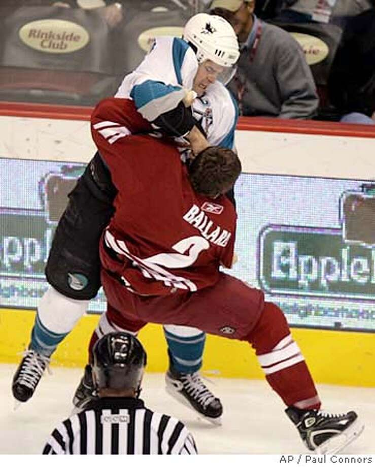San Jose Sharks center Patrick Marleau, top, lands a punch as he battles with Phoenix Coyotes defenseman Keith Ballard, bottom, in the first period of a hockey game Saturday, Jan. 13, 2007, in Glendale, Ariz.(AP Photo/Paul Connors) Photo: Paul Connors