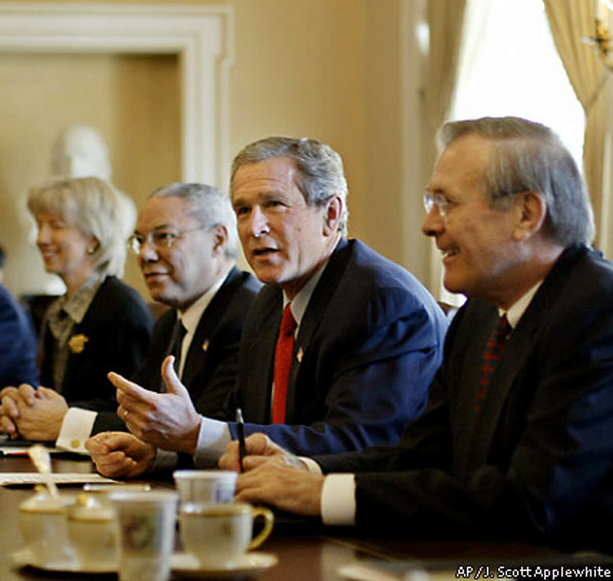 President Bush (second from right) and his Cabinet have set the United States on a course that is not supportive of disarmament agreements. Associated Press photo by J. Scott Applewhite