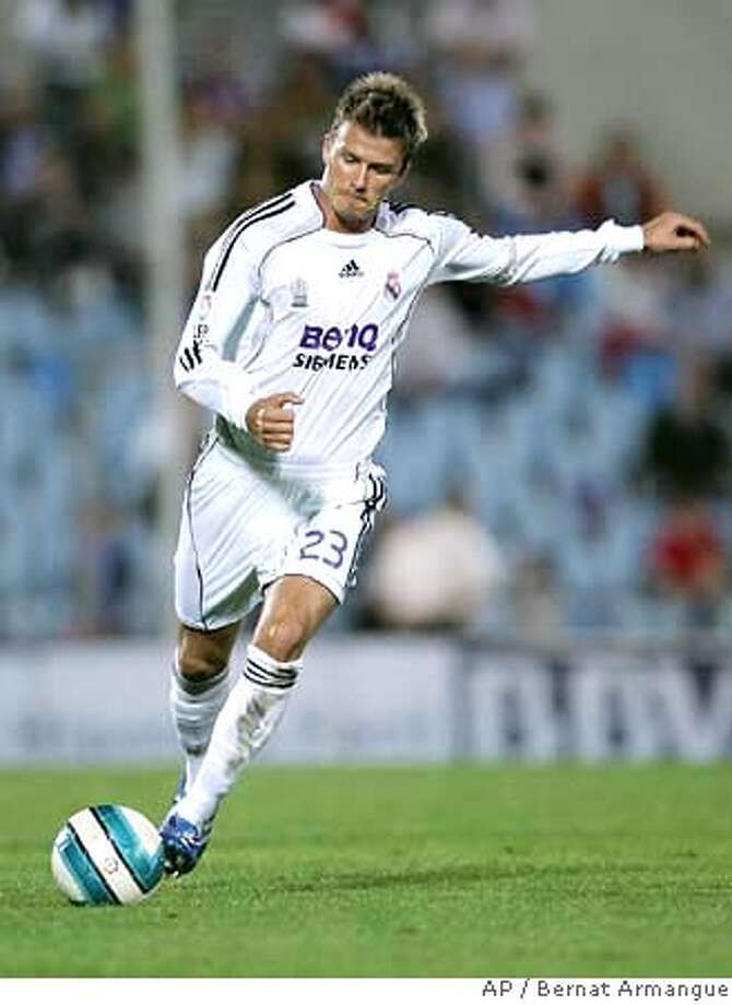 ** FILE ** Real Madrid player David Beckham shots during a Spanish League soccer match against Getafe CF at the Coliseum Alfonso Perez stadium in Getafe, near Madrid, Spain, Saturday, Oct.14 2006. English soccer player David Beckham will leave Real Madrid at the end of the season to join the Los Angeles Galaxy of Major League Soccer in a five-year deal it was announced Thursday Jan. 11, 2007. (AP Photo/Bernat Armangue) EFE OUT Photo: BERNAT ARMANGUE