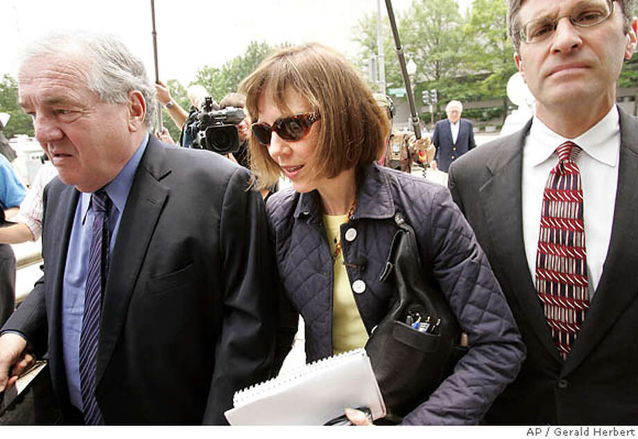 New York Times journalist Judith Miller, center, arrives at Federal Court in Washington Wednesday July 6, 2005. Miller and Time magazine reporter Matt Cooper face jail for contempt of court for refusing to divulge their sources who identified Valerie Plame as a CIA operative. (AP Photo/Gerald Herbert) Photo: GERALD HERBERT